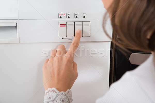 Kişi eller düğme bulaşık makinesi Stok fotoğraf © AndreyPopov