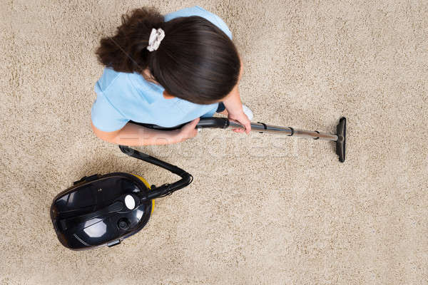 Woman Cleaning With Vacuum Cleaner Stock photo © AndreyPopov