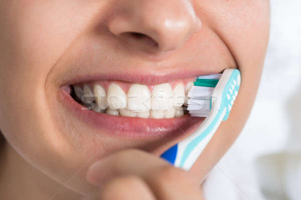 Woman Brushing Teeth At Home Stock photo © AndreyPopov