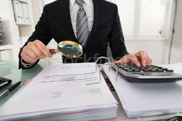 Businessman Analyzing Bills Stock photo © AndreyPopov