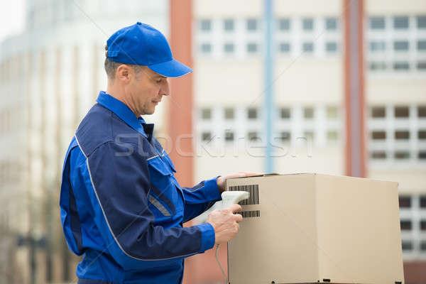 Futár karton dobozok vonalkód szkenner áll Stock fotó © AndreyPopov