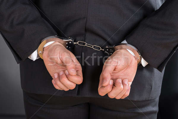 Close-up Of Businessman In Handcuffs Stock photo © AndreyPopov