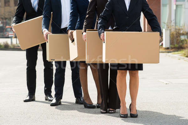 Businesspeople With Cardboard Boxes Standing In A Line Stock photo © AndreyPopov