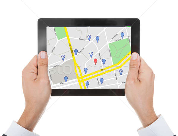 Person's Hand With Digital Tablet Showing Marker Location Icon Stock photo © AndreyPopov