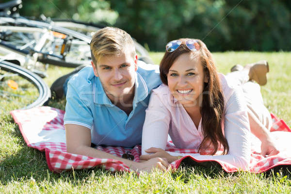 Happy Couple Laying Down On The Blanket At Park Stock photo © AndreyPopov