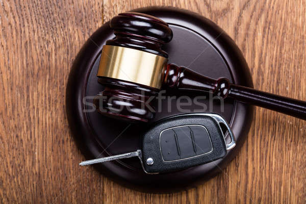 Car Key On Judges Gavel Stock photo © AndreyPopov
