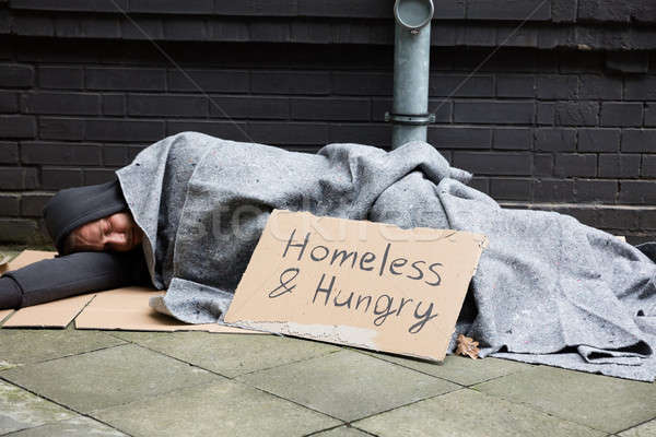Homeless And Hungry Man Sleeping Stock photo © AndreyPopov