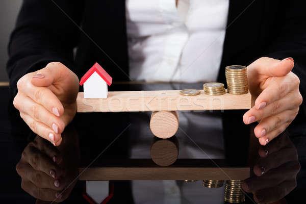 Modell ház pénz érmék egyensúlyoz hinta Stock fotó © AndreyPopov