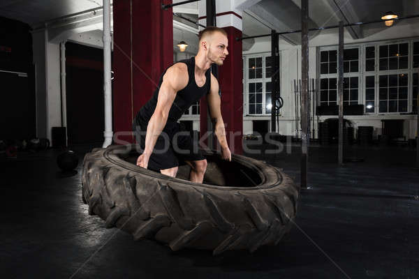 Man Working With Tire Stock photo © AndreyPopov