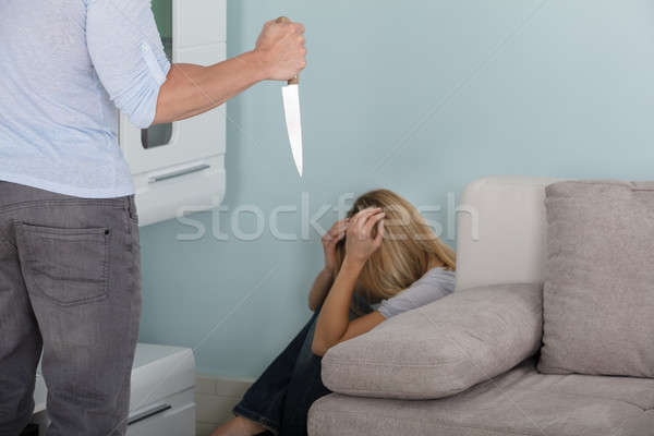 Man Holding Knife In Front Of A Frighten Woman Stock photo © AndreyPopov