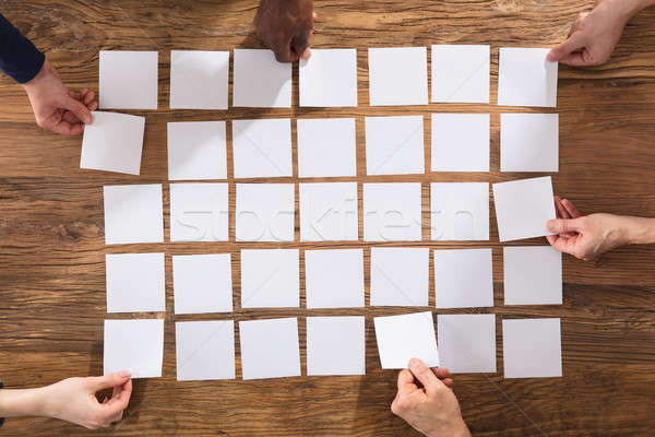 People Hands Arranging White Papers Stock photo © AndreyPopov