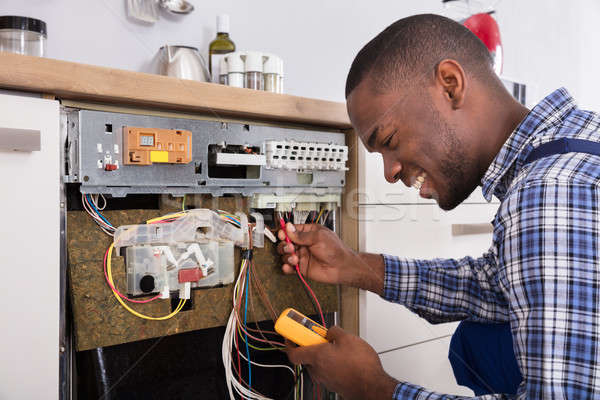 Technician Fixing Dishwasher With Digital Multimeter Stock photo © AndreyPopov