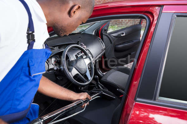 Worker Vacuuming Car Interior Stock photo © AndreyPopov
