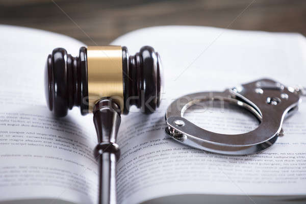 Close-up Of Wooden Mallet And Handcuffs Stock photo © AndreyPopov