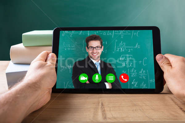Human Hand Video Conferencing With Male On Digital Tablet Stock photo © AndreyPopov