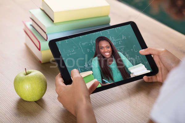Video Conferencing With Female Teacher On Digital Tablet Stock photo © AndreyPopov