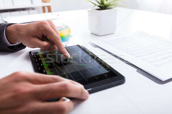 Businessperson Analyzing Graph On Digital Tablet Stock photo © AndreyPopov