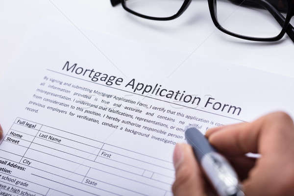 Human Hand Filling Mortgage Application Form Stock photo © AndreyPopov
