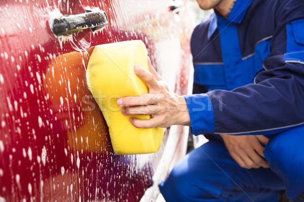 Worker's Hand Washing Red Car With Yellow Sponge Stock photo © AndreyPopov