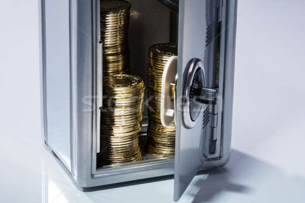 Open Safe With Stacked Coins Stock photo © AndreyPopov