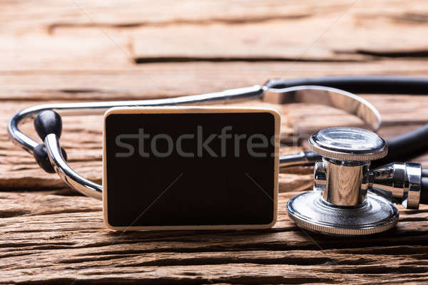 Stetoskop ahşap arka plan Metal bilim Stok fotoğraf © AndreyPopov