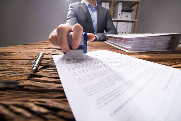 Close-up Of A Businessperson Approving Document Stock photo © AndreyPopov