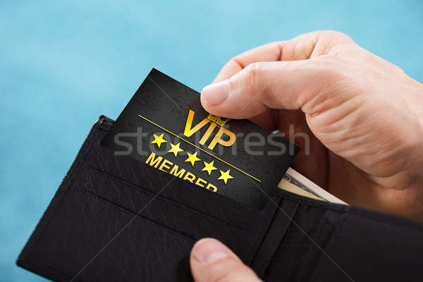 Person Removing Vip Member Card From Wallet Stock photo © AndreyPopov