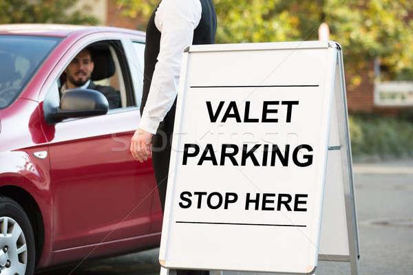 駐車場 文字 ホワイトボード ボード 立って ビジネスパーソン ストックフォト © AndreyPopov