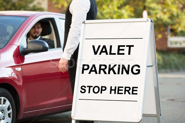 Parking texte bord permanent homme d'affaires Photo stock © AndreyPopov