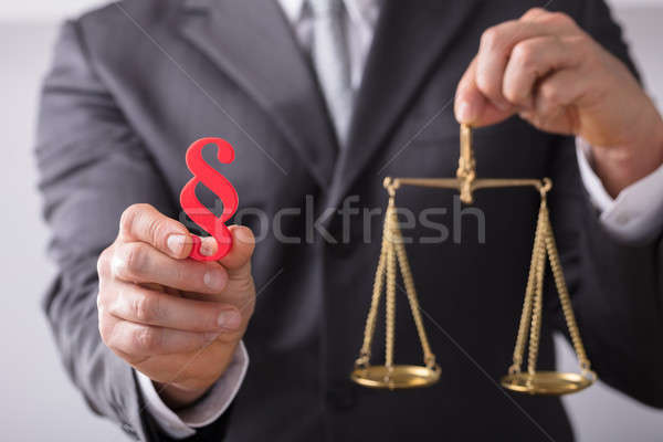 Judge Holding Paragraph Symbol And Justice Scale Stock photo © AndreyPopov