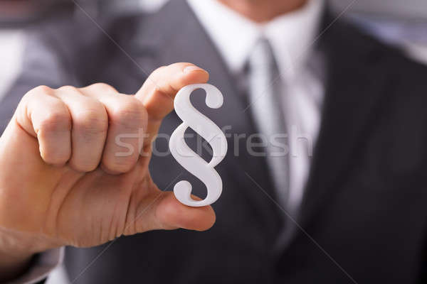 Businessperson Holding Paragraph Symbol Stock photo © AndreyPopov