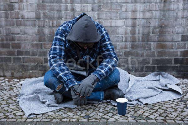 Dilenci oturma sokak yandan görünüş erkek tek kullanımlık Stok fotoğraf © AndreyPopov