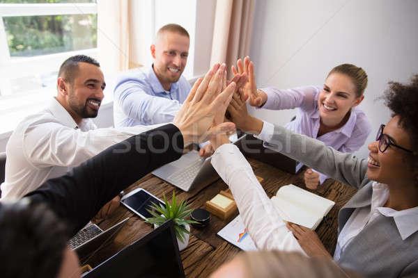üzletemberek pacsi iroda csoport boldog fiatal Stock fotó © AndreyPopov