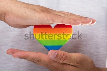 Man holding rainbow LGBT heart Stock photo © AndreyPopov