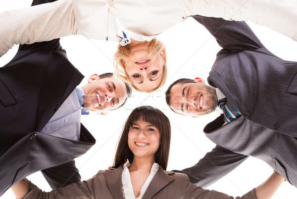 Stock photo: Group Of Businesspeople Putting Heads Together