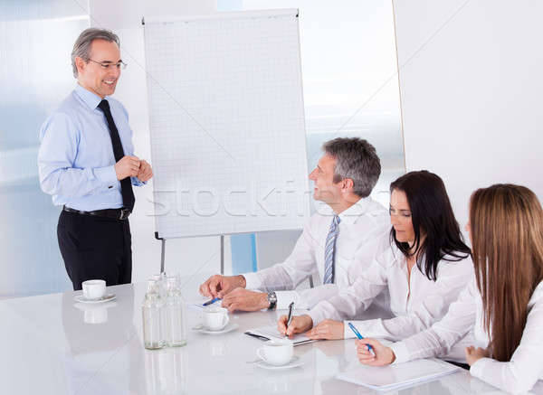 Businesspeople Discussing Project Stock photo © AndreyPopov