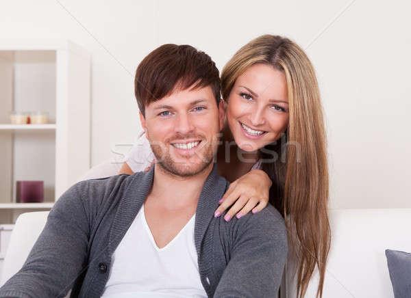 Gelukkig poseren woonkamer liefde paar Stockfoto © AndreyPopov