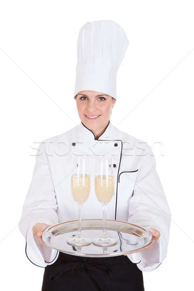 Female Chef Holding Champagne Stock photo © AndreyPopov