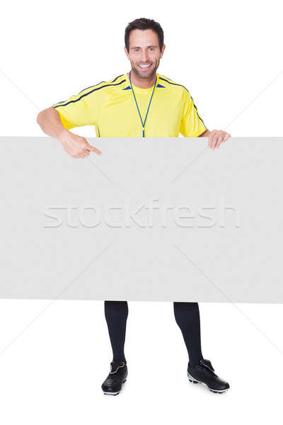 Soccer judge presenting empty banner Stock photo © AndreyPopov