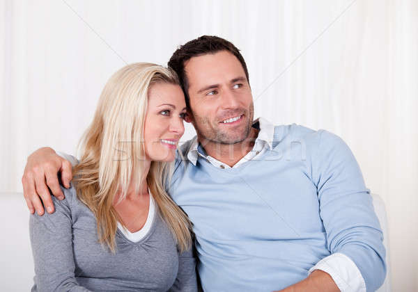Affectionate couple relaxing on a sofa Stock photo © AndreyPopov