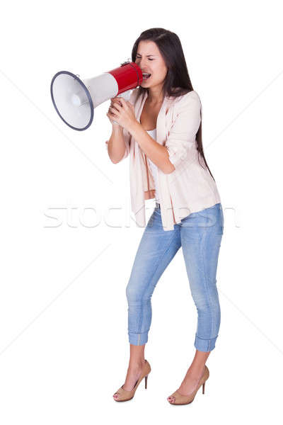 Woman shouting into a loud hailer Stock photo © AndreyPopov
