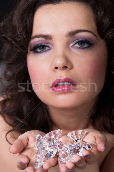 Young Woman Holding Diamonds Stock photo © AndreyPopov