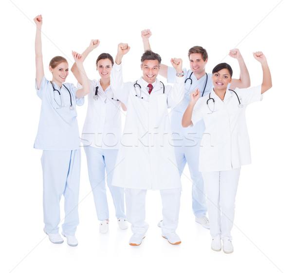 Group Of Doctors Raising Hand Stock photo © AndreyPopov