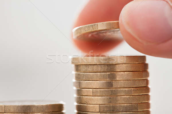 Businessman Hand Stacking Coins In Office Stock photo © AndreyPopov