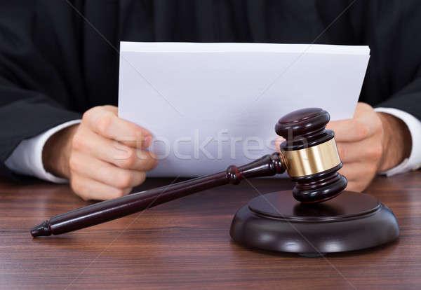 Judge Reading Documents At Desk Stock photo © AndreyPopov
