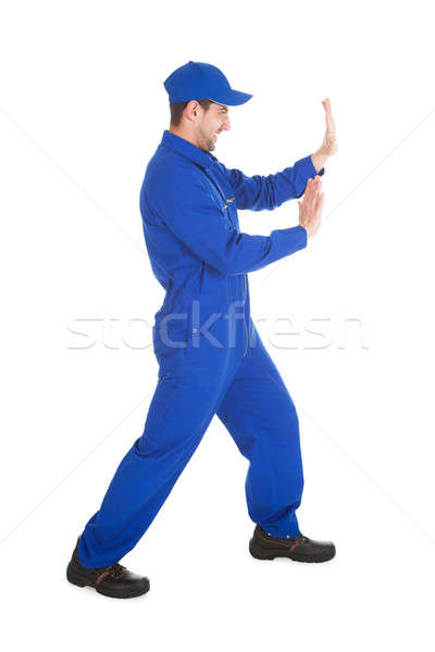 Confident Young Male Worker Pushing Empty Space Stock photo © AndreyPopov