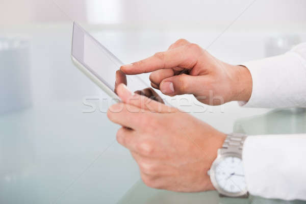 Cropped image of businessman's hands using digital tablet Stock photo © AndreyPopov