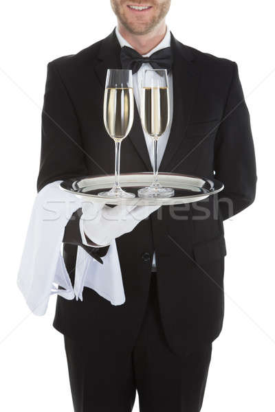 Pincér hordoz pezsgő fuvolák tálca fehér Stock fotó © AndreyPopov