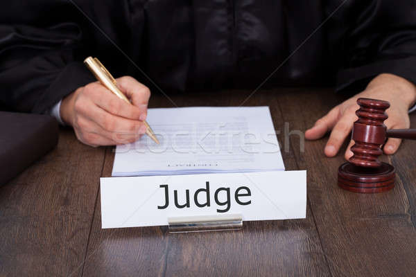 Judge Writing On Legal Documents Stock photo © AndreyPopov