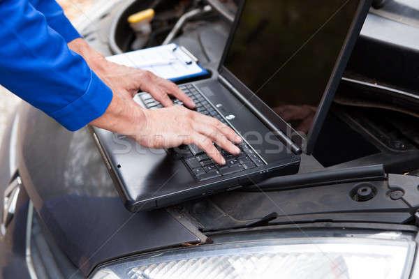 Car Mechanic Using Laptop Stock photo © AndreyPopov